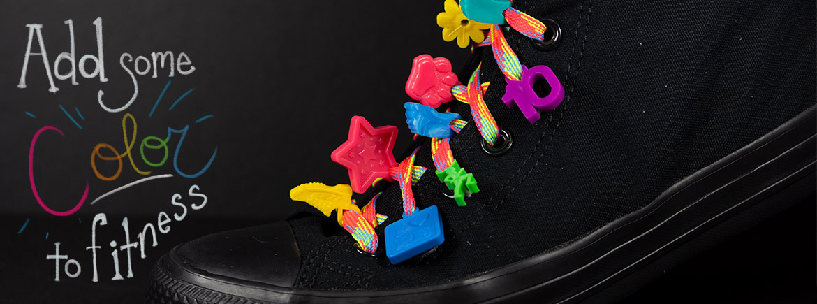 black Shoe with charms displayed on the shoelaces